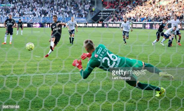 Goalkeeper Aleksandar Jovanovic of AGF Aarhus saves the penalty shoot from Jakob Poulsen of FC Midtjylland during the Danish Superliga match between...