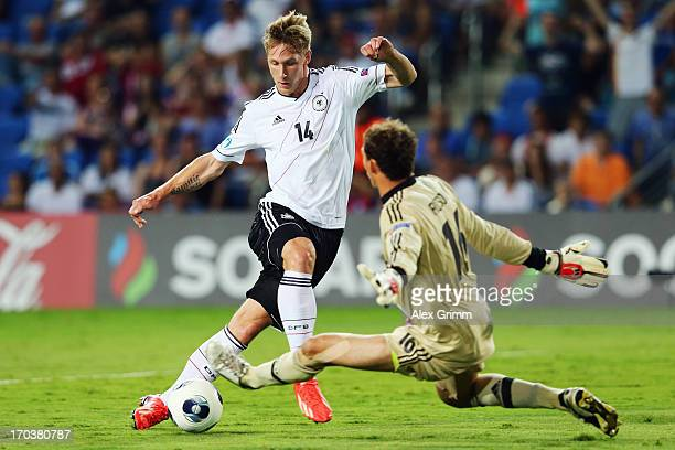 Goalkeeper Aleksandr Filtsov of Russia makes a save against Sebastian Polter of Germany during the UEFA European U21 Championship Group B match...