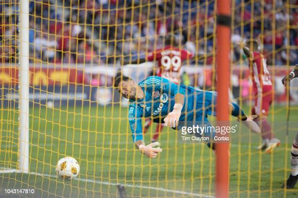 Goalkeeper Alex Bono of Toronto FC can't stop a low shot from Alejandro Romero Gamarra of New York Red Bulls for his sides first goal during the New...