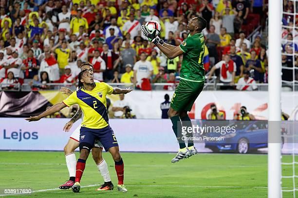 Goalkeeper Alexander Dominguez of Ecuador leaps to make a save as Arturo Mina defends during the second half of the 2016 Copa America Centenario...