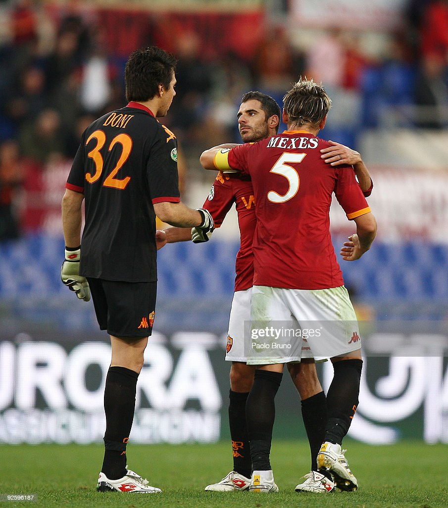 Goalkeeper Alexander Doni, Philippe Mexes (R) and Simone Perrotta of AS Roma celebrate victory after the Serie A match between AS Roma and Bologna FC at Stadio Olimpico on November 1, 2009 in Rome, Italy.