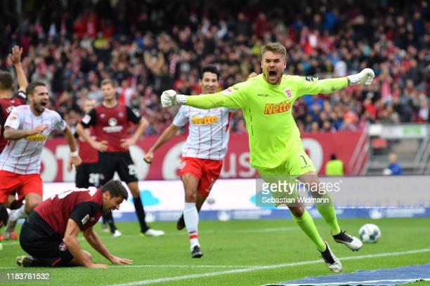 Goalkeeper Alexander Meyer of Regensburg celebrates after scoring his team's first goal during the Second Bundesliga match between 1. FC Nürnberg and...