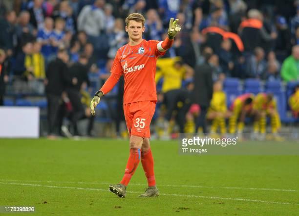 goalkeeper Alexander Nuebel of FC Schalke 04 gestures during the Bundesliga match between FC Schalke 04 and Borussia Dortmund at VeltinsArena on...