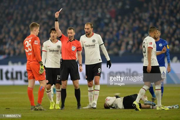 goalkeeper Alexander Nuebel of FC Schalke 04 gets the red card from referee Felix Zwayer during the Bundesliga match between FC Schalke 04 and...