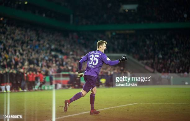 Goalkeeper Alexander Nuebel of Schalke celebrates his team's win after penalty shoot out after the DFB Cup match between 1. FC Koeln and FC Schalke...