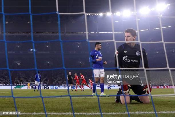 Goalkeeper Alexander Nuebel of Schalke reacts after Marcel Sabitzer of Leipzig scored his team's first goal during the Bundesliga match between FC...
