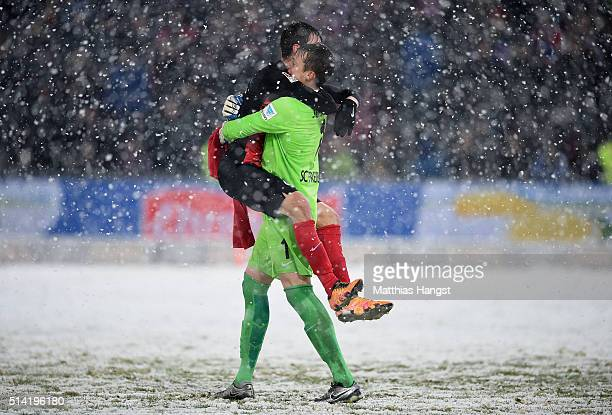 Goalkeeper Alexander Schwolow of Freiburg celebrates with Pascal Stenzel of Freiburg after the Second Bundesliga match between SC Freiburg and RB...