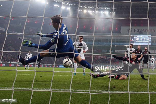 Goalkeeper Alexander Schwolow of Freiburg makes a save against Javier Hernandez of Leverkusen during the Bundesliga match between Bayer 04 Leverkusen...