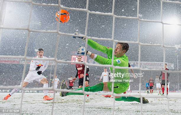 Goalkeeper Alexander Schwolow of Freiburg saves a ball in the last minute during the Second Bundesliga match between SC Freiburg and RB Leipzig at...
