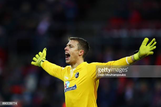 Goalkeeper Alexander Schwolow of SC Freiburg screams at his team mates during the Bundesliga match between 1 FC Koeln and SportClub Freiburg at...