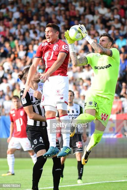 Goalkeeper Alexandre Letellier of Angers gathers the ball under pressure from Ezequiel Ponce of Lille during the Ligue 1 match between Angers SCO and...