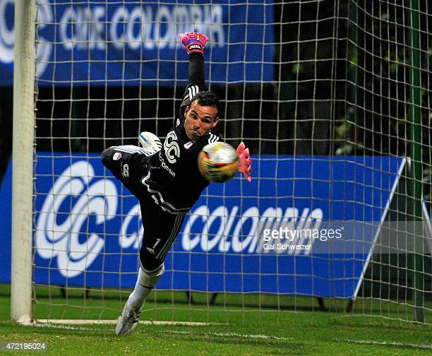 Goalkeeper Alexis Viera of America de Cali fails to stop a goal scored by Luis Payares of Atletico Bucaramanga during a match between America de Cali...