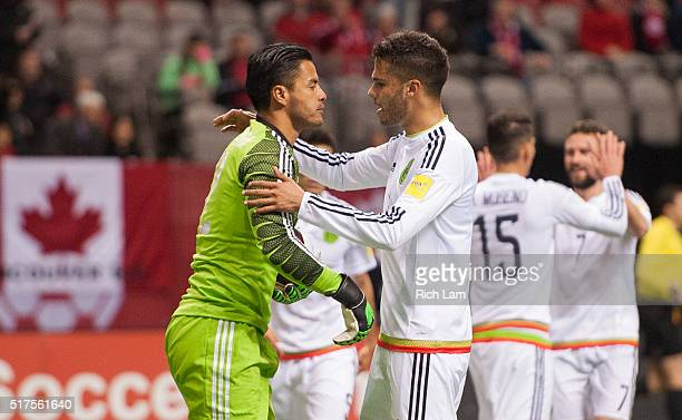 Goalkeeper Alfredo Talavera of Mexico is congratulated by teammate Yasser Corona after defeating Canada in FIFA 2018 World Cup Qualifier soccer...