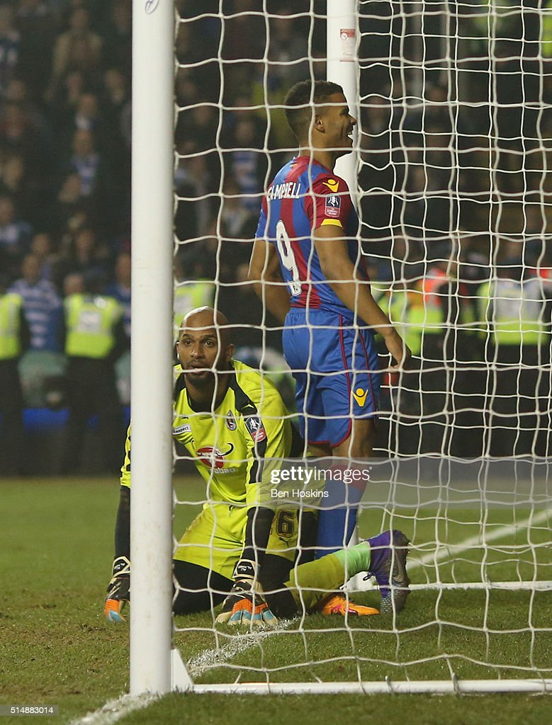 Goalkeeper Ali Al-Habsi of Reading looks dejected as Fraizer Campbell of Crystal Palace celebrates as he scores their second goal during the Emirates FA Cup sixth round match between Reading and Crystal Palace at Madejski Stadium on March 11, 2016 in Reading, England.