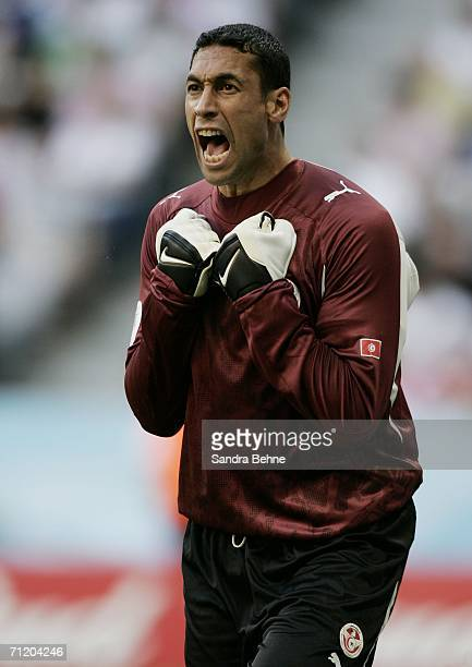 Goalkeeper Ali Boumnijel of Tunisia celebrates after teammate Zied Jaziri of Tunisia scores the opening goal during the FIFA World Cup Germany 2006...