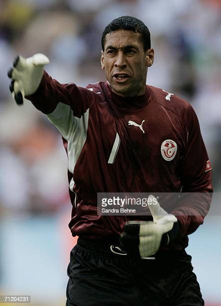 Goalkeeper Ali Boumnijel of Tunisia gestures to his teamates during the FIFA World Cup Germany 2006 Group H match between Tunisia and Saudi Arabia at...