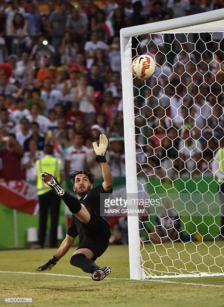 Goalkeeper Alireza Haghighi of Iran misses the ball during the penalty shootout during the Asian Cup quarterfinal football match between Iraq and...