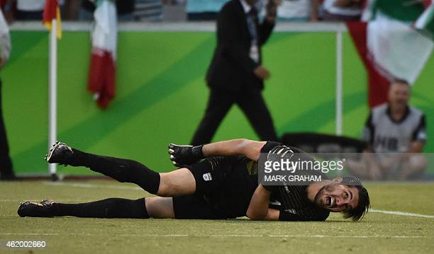 Goalkeeper Alireza Haghighi of Iran reacts to being brought down during the Asian Cup quarterfinal football match between Iraq and Iran in Canberra...