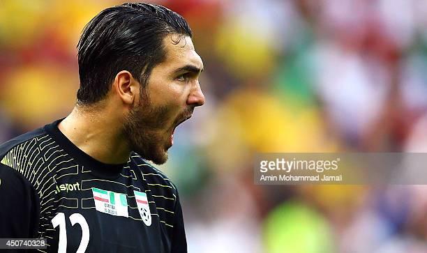 Goalkeeper Alireza Haghighi of Iran yells during the 2014 FIFA World Cup Brazil Group F match between Iran and Nigeria at Arena da Baixada on June 16...