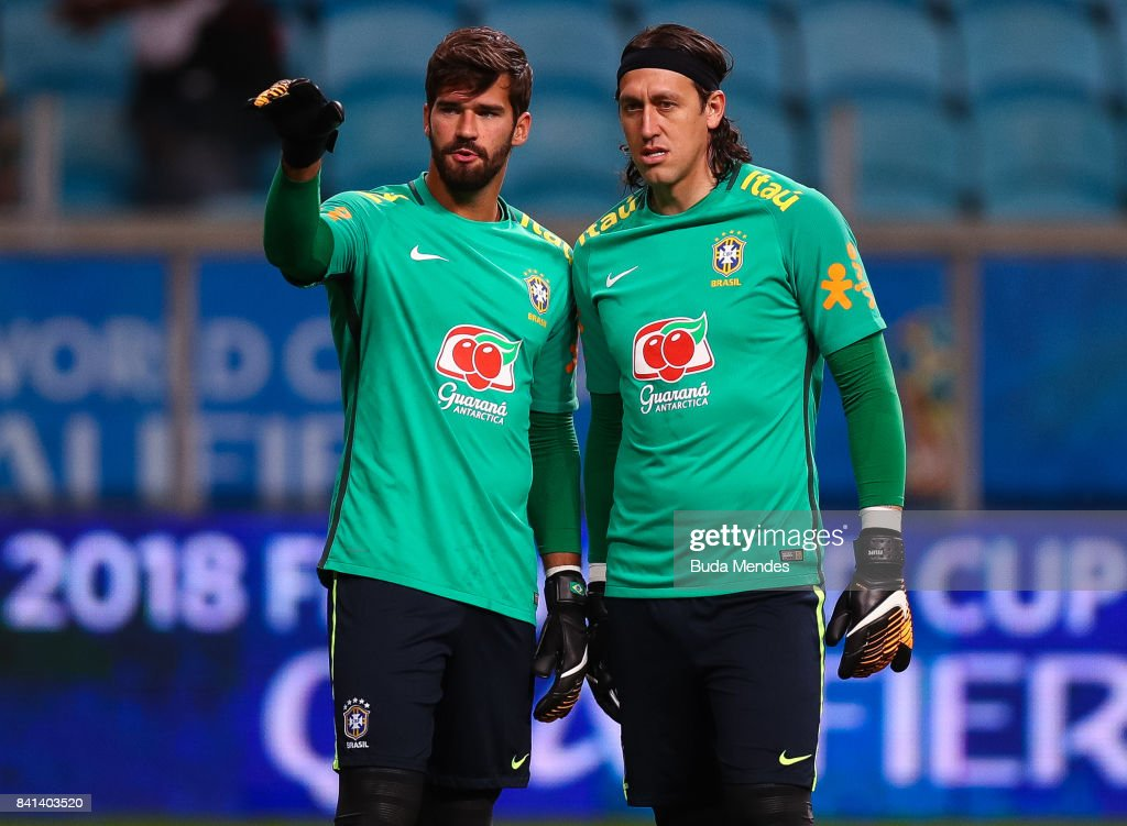 Goalkeeper Alisson (L) and Cassio of Brazil warm up before a match between Brazil and Ecuador as part of 2018 FIFA World Cup Russia Qualifier at Arena do Gremio on August 31, 2017 in Porto Alegre, Brazil.