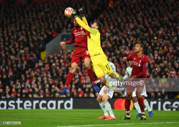Goalkeeper Alisson and Fabinho of Liverpool clear the ball during the UEFA Champions League Round of 16 First Leg match between Liverpool and FC...