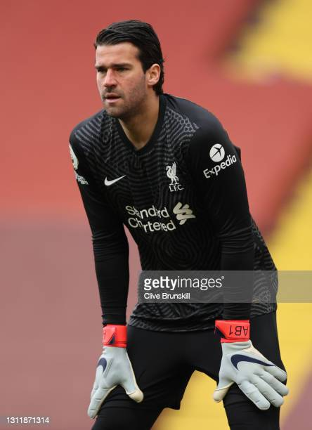 Goalkeeper Alisson Becker during the Premier League match between Liverpool and Aston Villa at Anfield on April 10, 2021 in Liverpool, England....