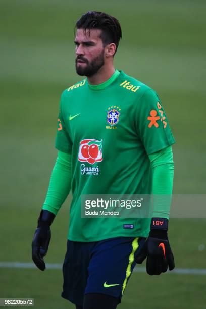 Goalkeeper Alisson Becker looks on during a training session of the Brazilian national football team at the squad's Granja Comary training complex on...