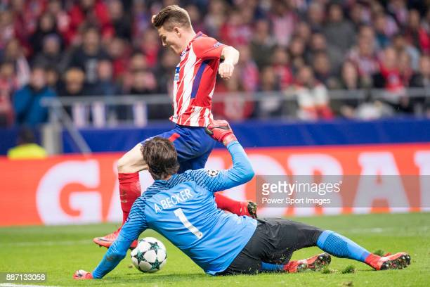 Goalkeeper Alisson Becker of AS Roma catching the ball during the UEFA Champions League 201718 match between Atletico de Madrid and AS Roma at Wanda...
