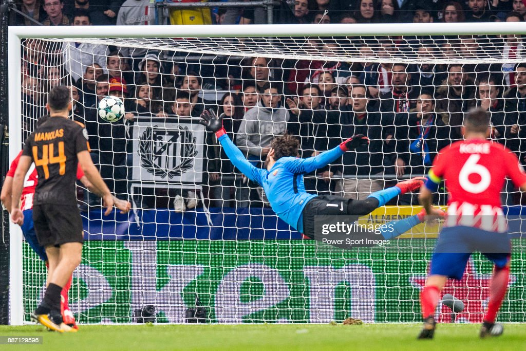 Goalkeeper Alisson Becker of AS Roma trying to catch the ball during the UEFA Champions League 2017-18 match at Wanda Metropolitano on 22 November 2017 in Madrid, Spain.