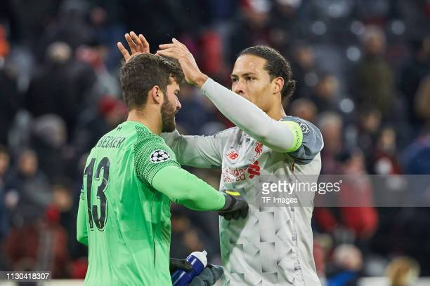 goalkeeper Alisson Becker of Liverpool and Virgil Van Dijk of Liverpool celebrate after winning the UEFA Champions League Round of 16 Second Leg...