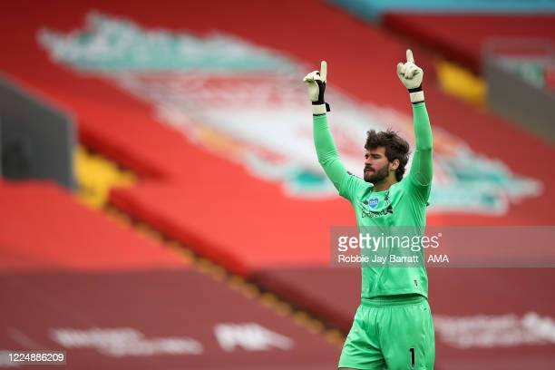 Goalkeeper Alisson Becker of Liverpool celebrates after his team scored the opening goal to make it 10 during the Premier League match between...