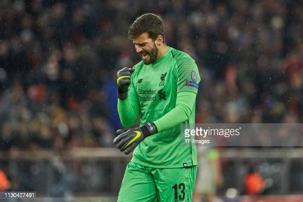 goalkeeper Alisson Becker of Liverpool celebrates after his team's third goal during the UEFA Champions League Round of 16 Second Leg match between...