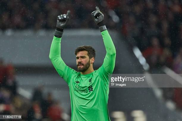 goalkeeper Alisson Becker of Liverpool celebrates after his team's second goal during the UEFA Champions League Round of 16 Second Leg match between...