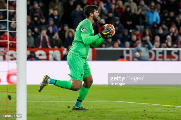 goalkeeper Alisson Becker of Liverpool controls the ball during the UEFA Champions League Round of 16 Second Leg match between FC Bayern Muenchen and...