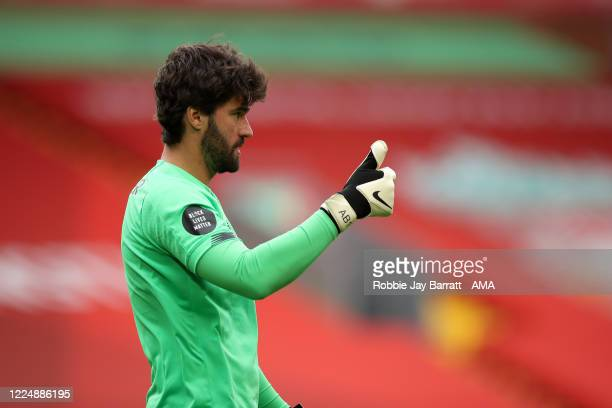 Goalkeeper Alisson Becker of Liverpool during the Premier League match between Liverpool FC and Aston Villa at Anfield on July 5 2020 in Liverpool...