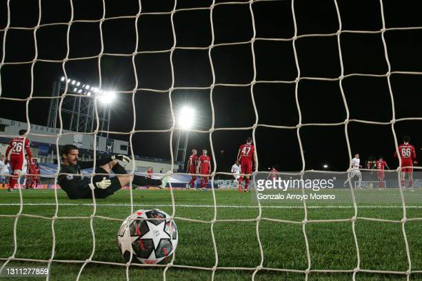 Goalkeeper Alisson Becker of Liverpool FC reacts as Real Madrid team celebrates scoring their third goal during the UEFA Champions League Quarter...