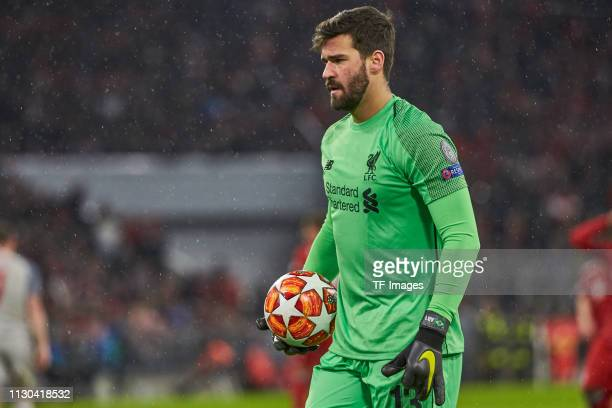 goalkeeper Alisson Becker of Liverpool looks on during the UEFA Champions League Round of 16 Second Leg match between FC Bayern Muenchen and...