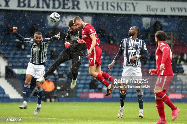 Goalkeeper Alisson Becker of Liverpool scores a goal to make it 1-2 during the Premier League match between West Bromwich Albion and Liverpool at The...
