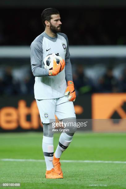 Goalkeeper Alisson of Brazil holds the ball during the international friendly match between Germany and Brazil at Olympiastadion on March 27 2018 in...