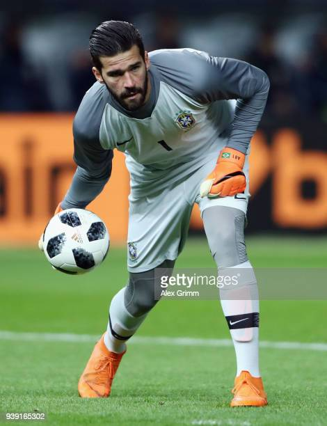 Goalkeeper Alisson of Brazil rolls the ball during the international friendly match between Germany and Brazil at Olympiastadion on March 27 2018 in...