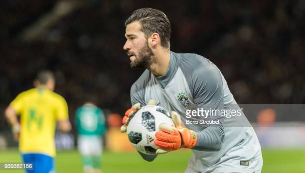 Goalkeeper Alisson of Brazil saves a ball during the International friendly match between Germany and Brazil at Olympiastadion on March 27 2018 in...
