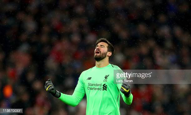 Goalkeeper Alisson of Liverpool celebrates during the UEFA Champions League Round of 16 Second Leg match between FC Bayern Muenchen and Liverpool at...
