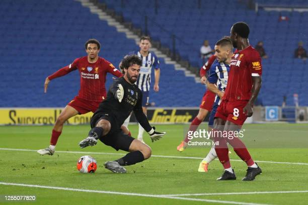 Goalkeeper Alisson of Liverpool saves from Neal Maupay of Brighton and Hove Albion during the Premier League match between Brighton Hove Albion and...