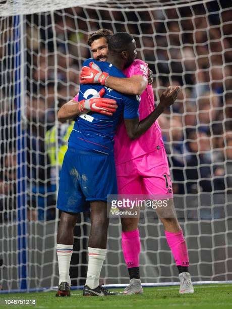 Goalkeeper Alisson Ramses Becker of Liverpool embraces Antonio Rüdiger of Chelsea after the Premier League match between Chelsea FC and Liverpool FC...