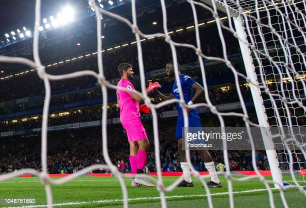 Goalkeeper Alisson Ramses Becker of Liverpool shakes hands with Antonio Rüdiger of Chelsea after the Premier League match between Chelsea FC and...