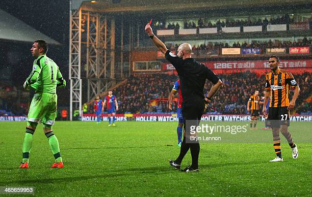 Goalkeeper Allan McGregor of Hull City is shown the red card by referee Roger East during the Barclays Premier League match between Crystal Palace...