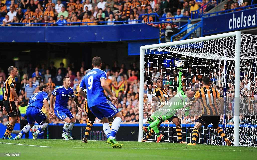 Goalkeeper Allan McGregor of Hull City makes a save as Branislav Ivanovic and John Terry of Chelsea look on during the Barclays Premier League match between Chelsea and Hull City at Stamford Bridge on August 18, 2013 in London, England.