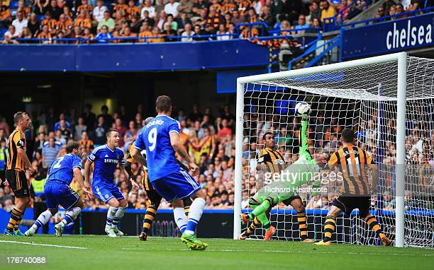Goalkeeper Allan McGregor of Hull City makes a save as Branislav Ivanovic and John Terry of Chelsea look on during the Barclays Premier League match...