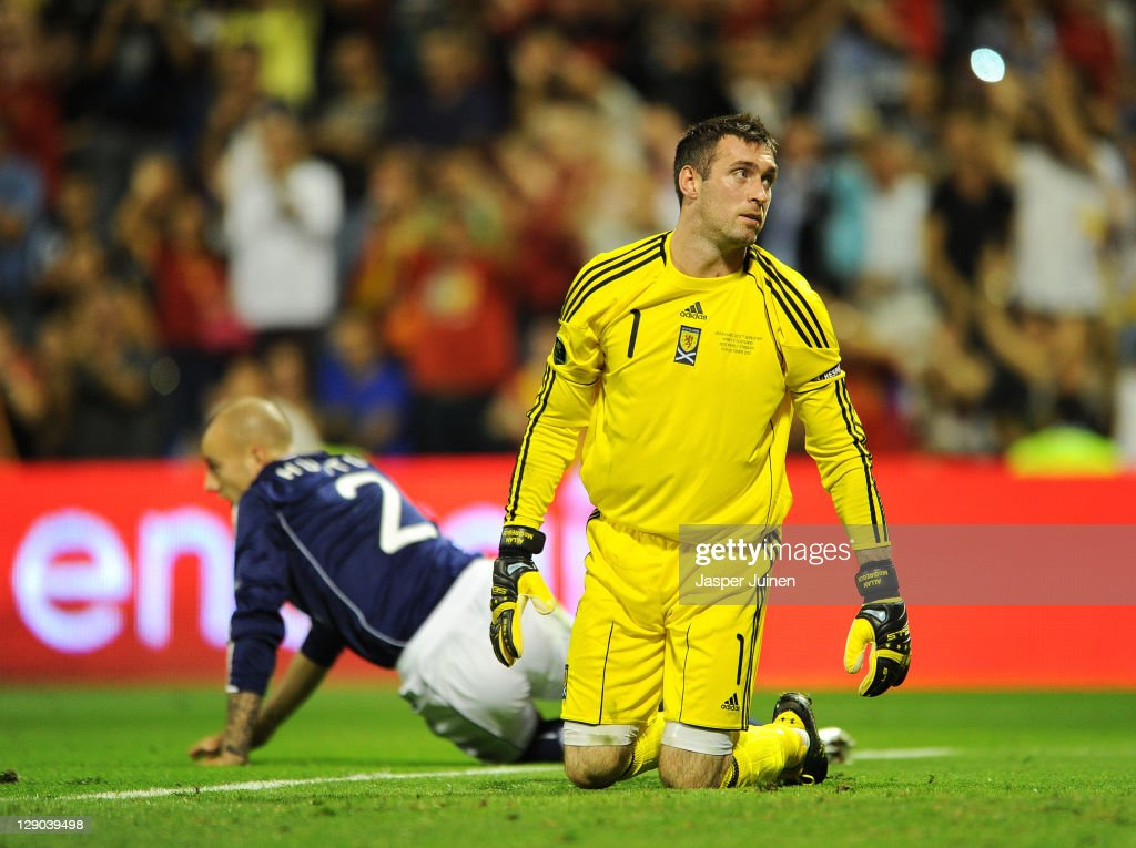 Goalkeeper Allan McGregor of Scotland reacts after conceding his sides third goal backdropped by his teammate Alan Hutton of Scotland during the UEFA EURO 2012 Group I Qualifier between Spain and Scotland at the Rico Perez stadium on October 11, 2011 in Alicante, Spain.