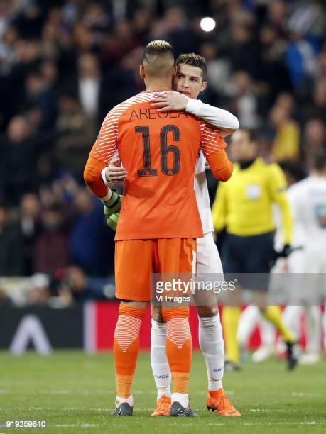 goalkeeper Alphonse Areola of Paris SaintGermain Cristiano Ronaldo of Real Madrid during the UEFA Champions League round of 16 match between Real...